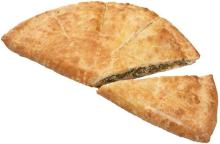 """""""Gianiotiki"""" Pie with greens layered in a thin dough"""