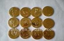 Gold coin shaped dark chocolate candy