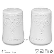 round white embossed ceramic salt and pepper jars