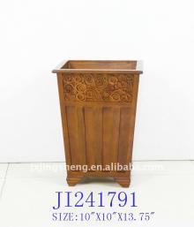 Wooden trash bin with cinnamon decoration