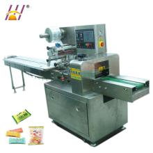 Horizontal pillow packaging machine for pies, roll, chocolate, candies